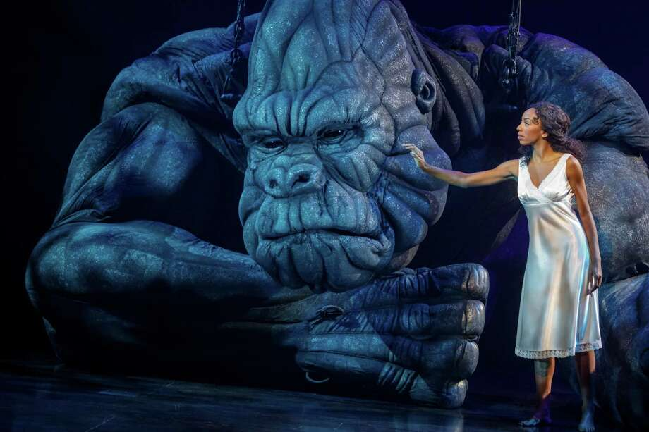 "Christiani Pitts as Ann Darrow in the Broadway production of ""King Kong."" Khadija Tariyan, below, is one of the puppeteers guiding the massive animatronic puppet. Photo: Contributed Photo"