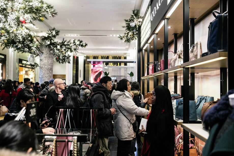 74818f9f9e5f20 Shoppers browse Coach handbags at the Macy's flagship store in New York on  Nov. 22