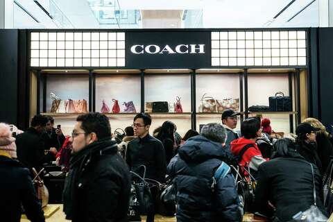 8dfc8eb9e56e25 Shoppers browse Coach handbags at the Macy's flagship store in New York on  Nov. 22