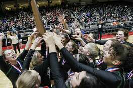 Kingwood Park celebrates winning the Class 5A State Championship volleyball game over Love Joy at the Curtis Culwell Center in Garland, Texas, Saturday, November 17, 2018. Special to the Houston Chronicle/Brandon Wade.