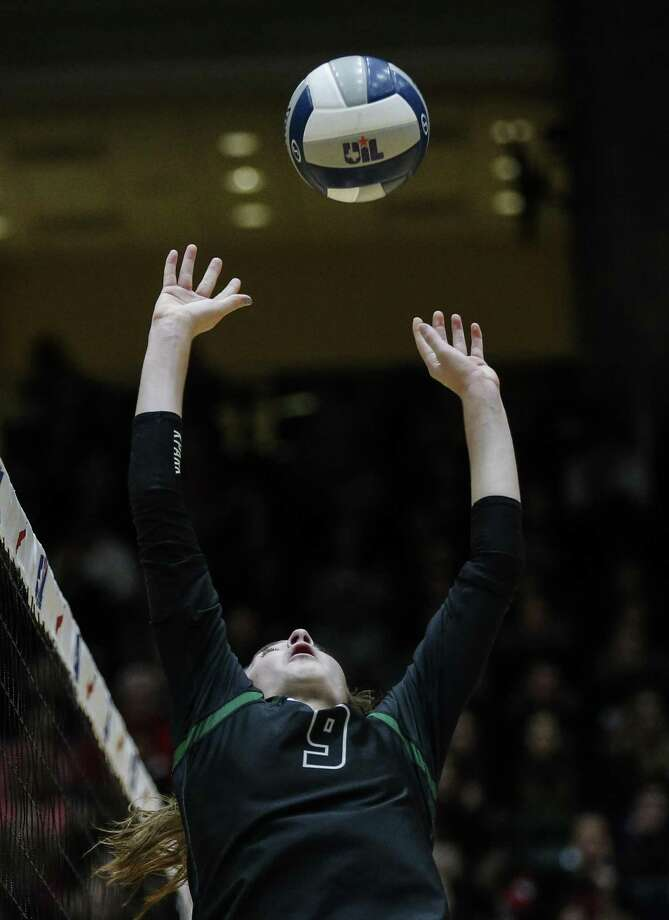 Kingwood Park senior Andie Unwin sets the ball during a Class 5A State Championship volleyball game against Love Joy at the Curtis Culwell Center in Garland, Texas, Saturday, November 17, 2018. Special to the Houston Chronicle/Brandon Wade. Photo: Brandon Wade, STR / SPECIAL/BRANDON WADE / Brandon Wade