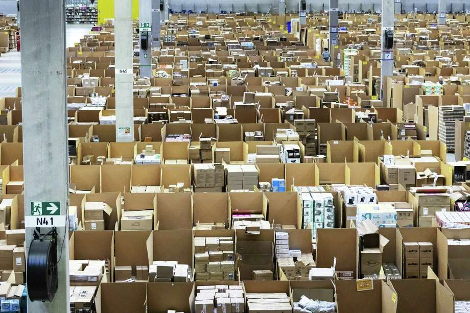 Boxes and parcels sit stacked in bays ahead of shipping from an Amazon.com fulfilment center in Koblenz, Germany, on Nov. 23, 2018. Photo: Alex Kraus/Bloomberg / Bloomberg
