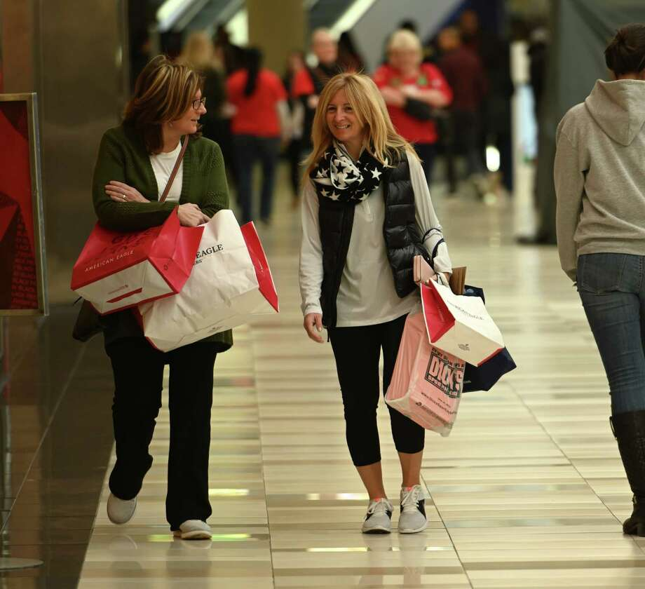 Karen Mein, left and Karen Ratigan both of Latham arrived at 6:00 a.m. this morning and joined shoppers that were out in force at Crossgates Mall on Black Friday Nov. 23, 2018 in Albany, N.Y.  (Skip Dickstein/Times Union) Photo: SKIP DICKSTEIN, Albany Times Union / 20045541A