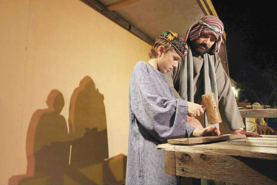 "Todd Crabtree, right, goes through a scene with his son, Nate, during a rehearsal for ""Bethlehem City"" at West Conroe Baptist Church. The event, where more than 100 actors reenactment scenes from Jesus' life, opens to the public Thursday and will run through Sunday for the next two weeks. To view or purchase this photo and others like it, visit HCNpics.com. Photo: Staff Photo By Jason Fochtman"