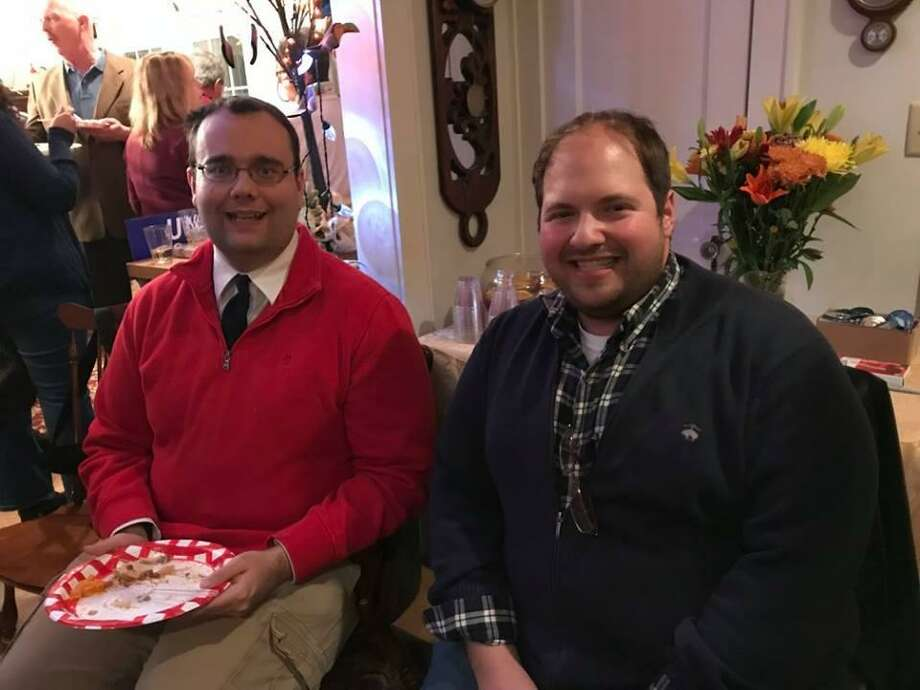 Bobby Berriault, left, and Peter J.Y. Brazaitis were among the guests at at recent Democrats' victory party and potluck in Litchfield. Photo: Audrey Blondin / Contributed Photo /