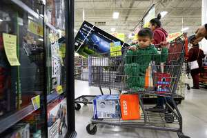 Alberto Garza, 4, looks at electronic games early on Black Friday, Nov. 23, 2018, at the H-E-B Plus on South Zarzamora. Alberto was accompanied by his father, Oscar Garza, who said that Alberto is interested in anything about dinosaurs.