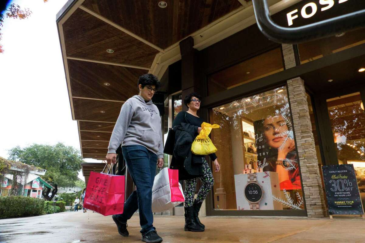 Shoppers walk the mall at The Shops at La Cantera on Nov. 23, 2018.