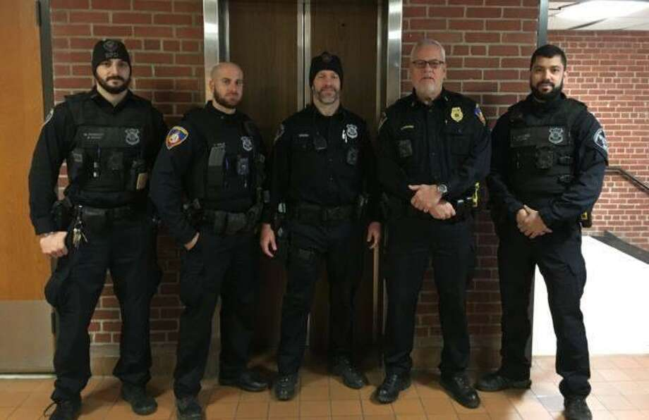 Patrol officers from left: Matt Romano, Jon Gale, Jason Deems, Lt. Gene Dohmann and Jay Alvarez are among about 50 Stamford officers participating in the No Shave November cancer fundraiser this year in Stamford. Photo: Stamford Police / Contributed