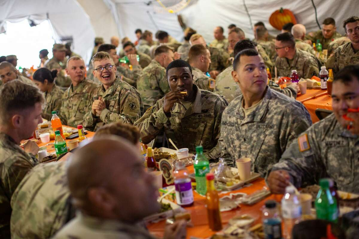 DONNA, TX - NOVEMBER 22: U.S. Army troops deployed to the U.S.-Mexico border eat a Thanksgiving meal at a base near the Donna-Rio Bravo International Bridge on November 22, 2018 in Donna, Texas. Culinary specialists prepared 34 Turkeys along with a full Thanksgiving buffet for the hundreds of troops stationed between Donna and Weslaco, Texas. (Photo by Tamir Kalifa/Getty Images)