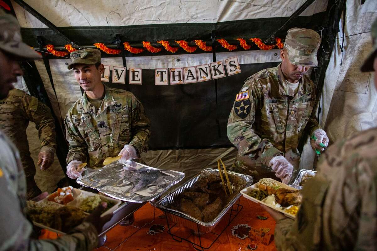 DONNA, TX - NOVEMBER 22: U.S. Army soldiers deployed to the U.S.-Mexico border serve a Thanksgiving meal to fellow troops at a base near the Donna-Rio Bravo International Bridge on November 22, 2018 in Donna, Texas. Culinary specialists prepared 34 Turkeys along with a full Thanksgiving buffet for the hundreds of troops stationed between Donna and Weslaco, Texas. (Photo by Tamir Kalifa/Getty Images)