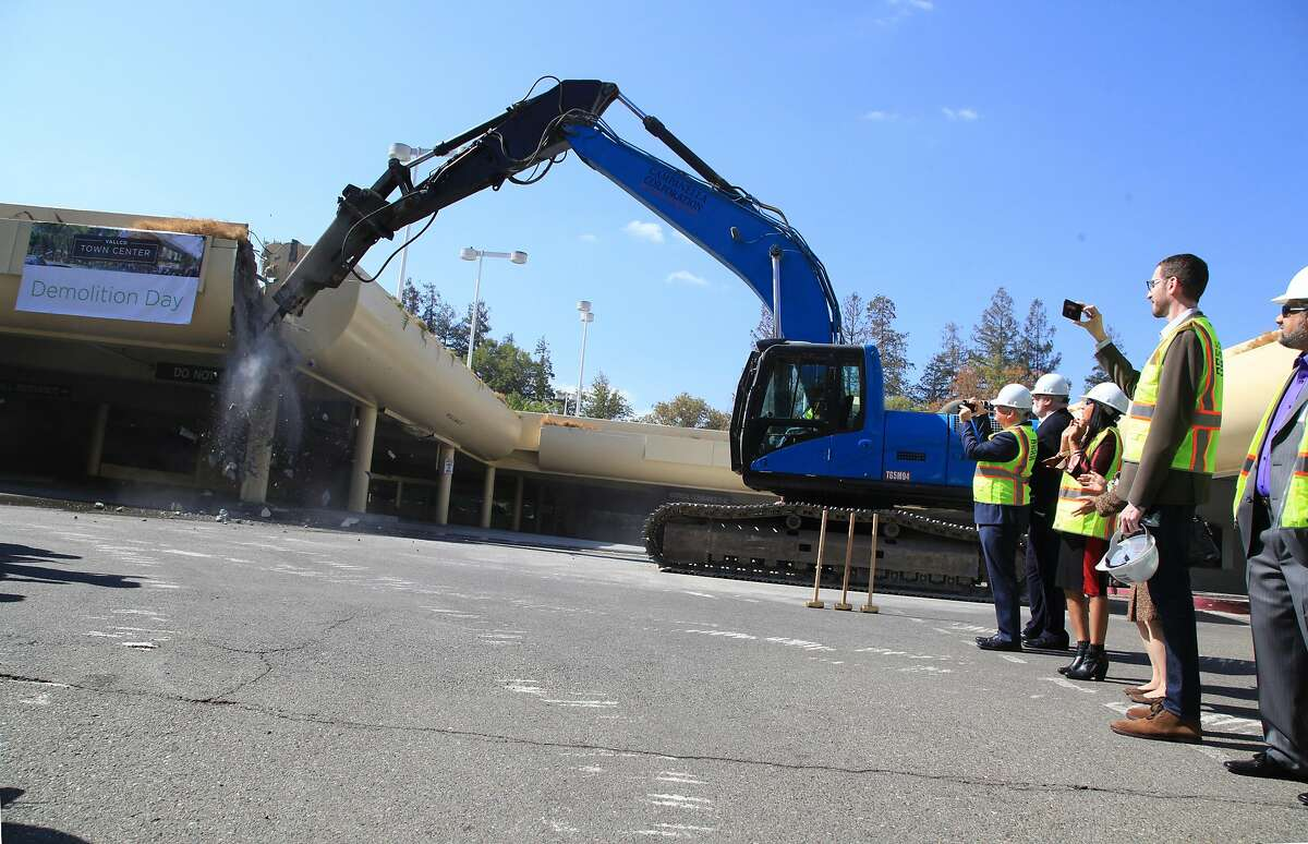 Demolition begins on the parking structure at Vallco Town Center in Cupertino, Calif. on Oct. 11, 2018. The razing of the parking structure was a prelude to the eventual demollition of the aging and all-but-vacant walk-through shopping center which is the subject of an intense community conflict regarding proposed redevelopment of the site.