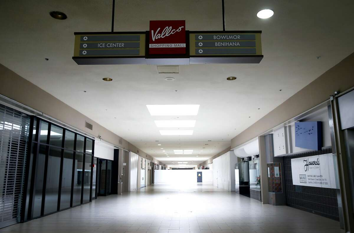 A sign guides the few customers visiting the Vallco shopping mall to businesses that remain open at the shopping center in Cupertino, Calif. on Wednesday, Feb. 14, 2018. Few tenants remain at the mall in the western Santa Clara Valley, including an AMC Theater and a couple of restaurants, but it is largely abandoned.
