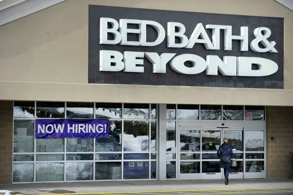 """Bed Bath & Beyond in Brookfield has a """"now hiring"""" sign it's window, Friday, March 9, 2018."""