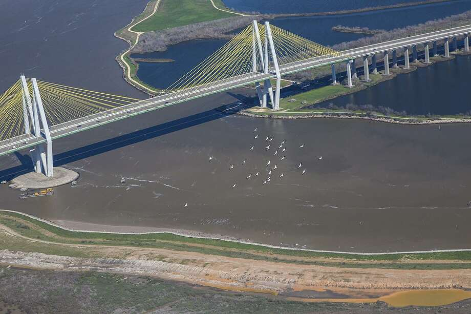 A flock of American white pelicans flies beside the Fred Hartman Bridge over the Houston Ship Channel. Baytown has been ranked in a data study as one of the best places to rent. Photo: Kathy Adams Clark / Kathy Adams Clark/KAC Productions / Kathy Adams Clark/KAC Productions