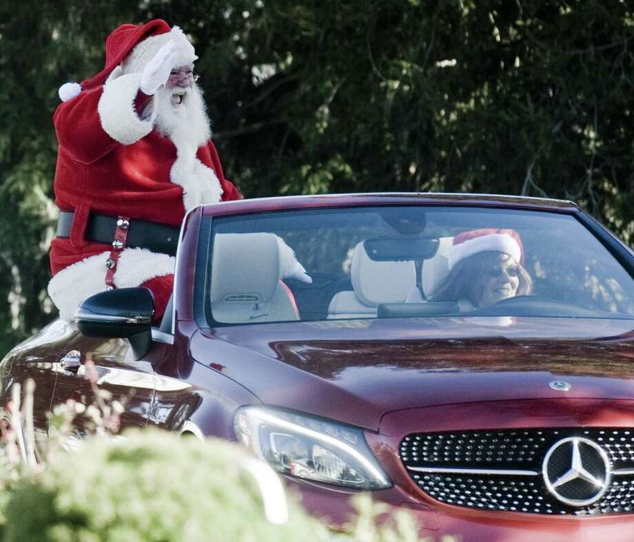 Santa Claus arrives by car at the Sam Bridge Nursery. Friday, Nov. 23, 2018 Photo: Scott Mullin / For Hearst Connecticut Media / The News-Times Freelance