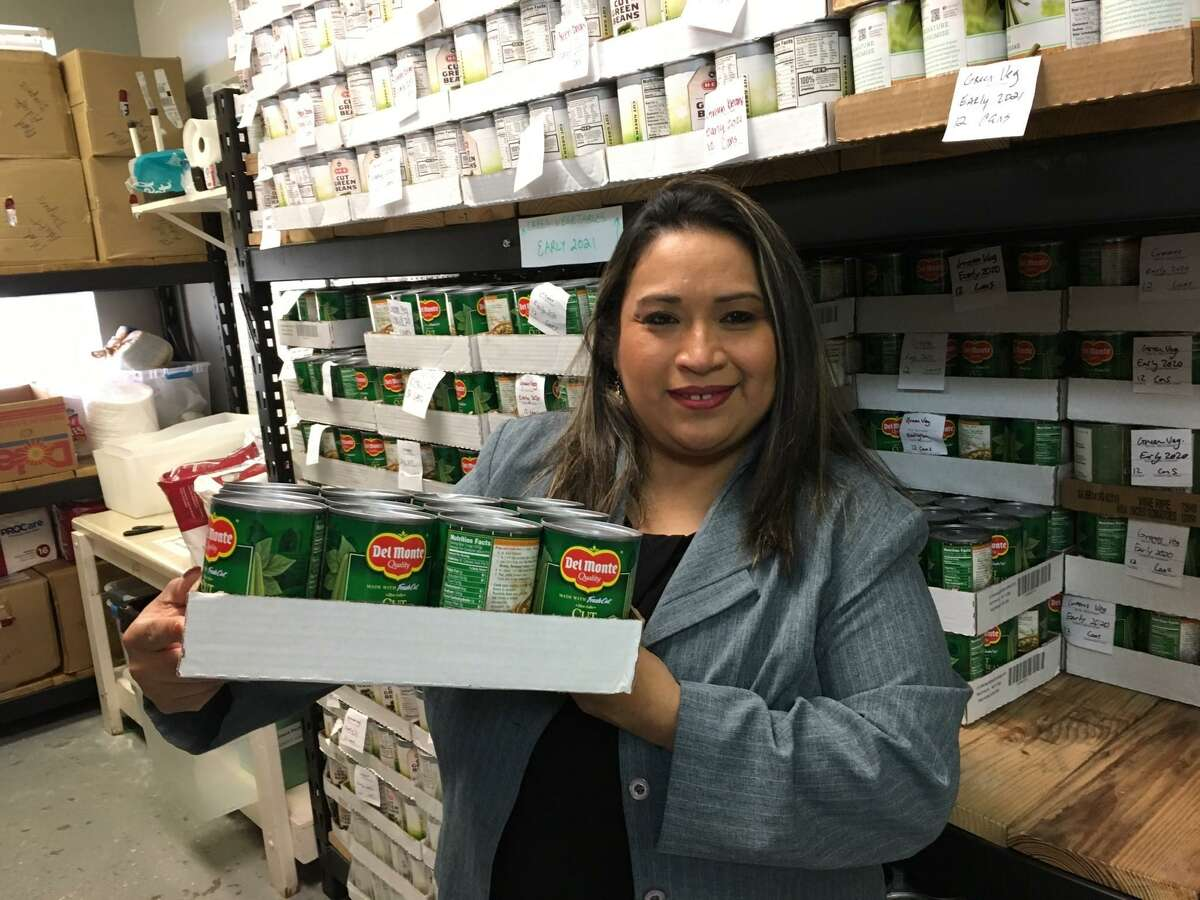 Deysi Crespo has served as executive director of Katy Christian Ministries for four years. The KCM food pantry recently changed to a client choice model in which clients can fill their carts with items they choose from the shelves. On Monday, Nov. 12, the pantry served a record number of clients - 98, said Crespo.