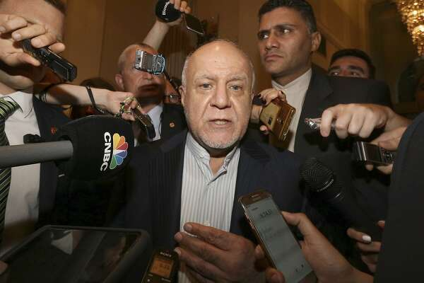 FILE - In this June 19, 2018 file photo, Iran's Minister of Petroleum Bijan Zangeneh speaks to journalists at a hotel in Vienna, Austria. On Thursday, Nov. 8, 2018, Iranian state TV quoted the minster as predicting a painful time for international oil customers as U.S. sanctions take hold, saying waivers that Washington granted to eight major oil-importing countries are not enough for market demands. (AP Photo/Ronald Zak, File)