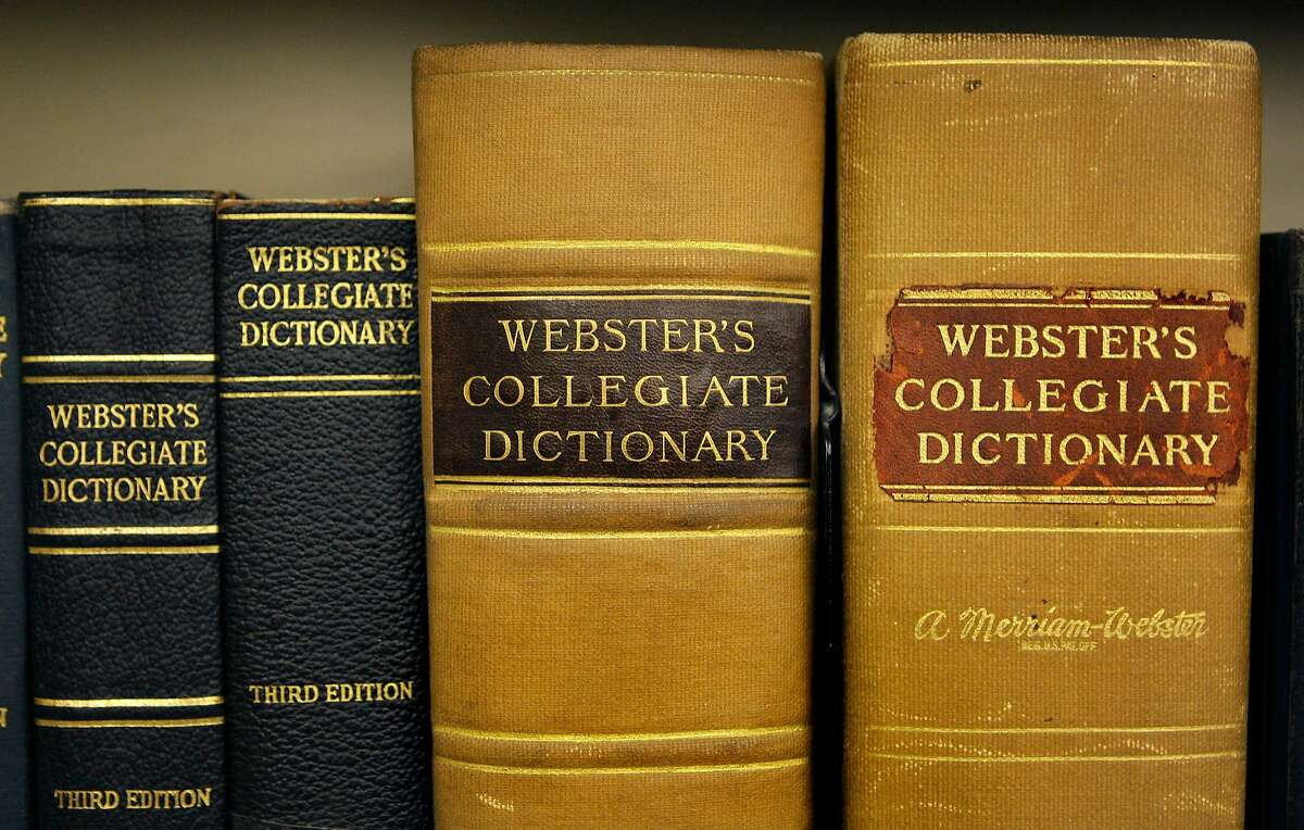 Archive copies of the Collegiate Dictionary rest on a bookshelf at the headquarters of the Merriam-Webster dictionary publisher in Springfield, Mass., Wednesday July 1, 2009. (AP Photo/Charles Krupa)