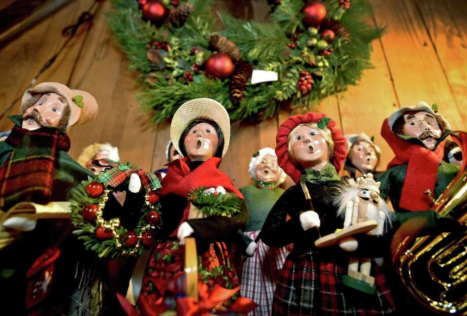 Caroling statuettes are on display at the Pink Sleigh in Westbrook, a Christmas-themed