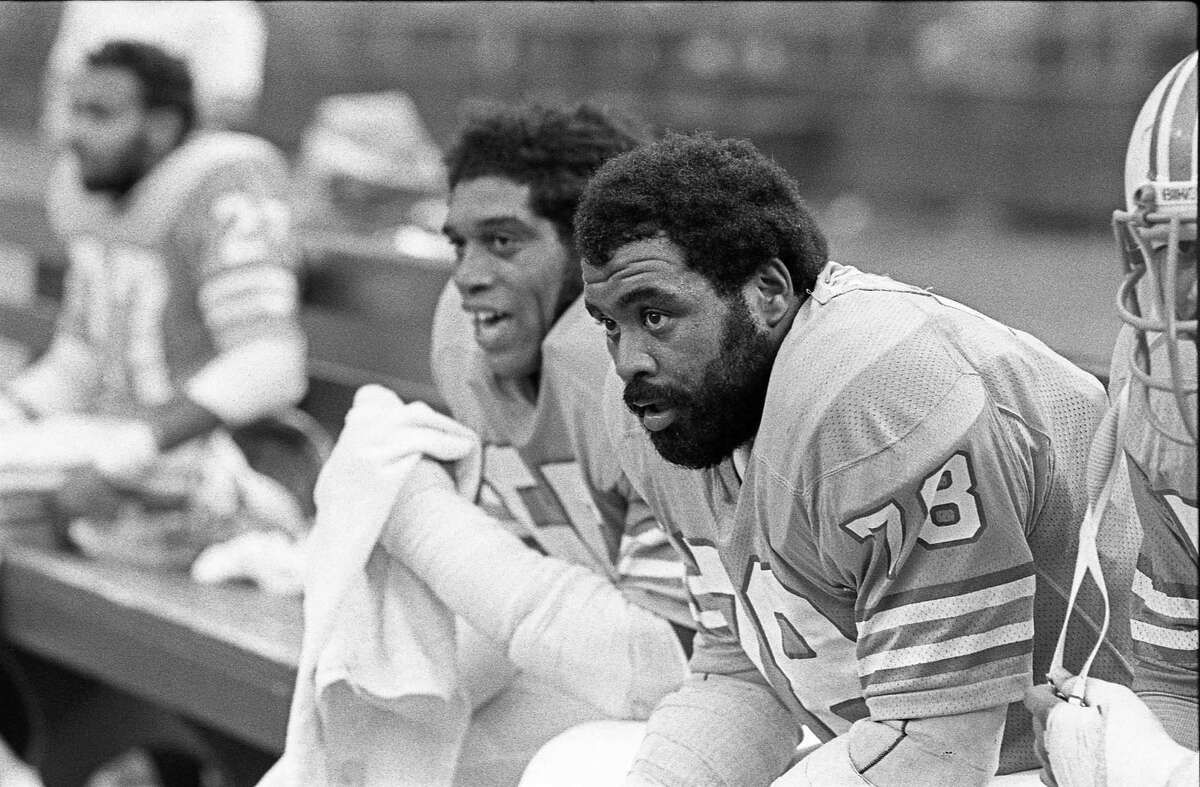 Houston Oilers Elvin Bethea (65) and Curley Culp (78) take a breather on the bench in the Astrodome in 1975.