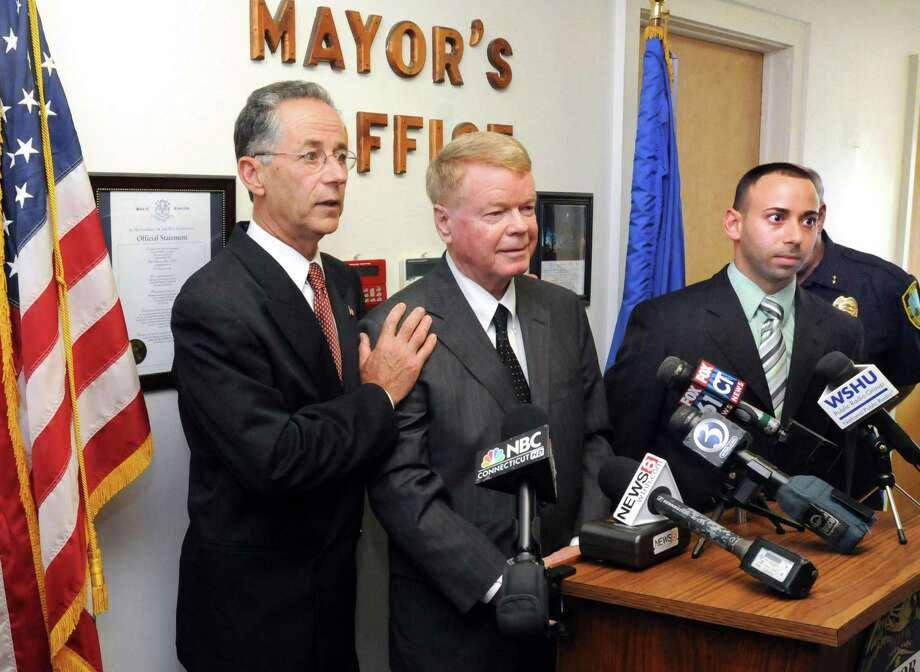 During a 2012 news conference in reaction to a federal court decision that East Haven was not responsible for damages for the controversial shooting death of Malik Jones, an African-American, Mayor Joseph Maturo, left, was joined by attorney Hugh Keefe, right, and attorney Joseph Zullo, far right. Keefe currently represents the town in a lawsuit filed against Maturo and town officials over the alleged retaliation against East Haven Police Officer Vincent Ferrara, who helped federal investigators send four cops to prison for violating the rights of Latino residents. Photo: /