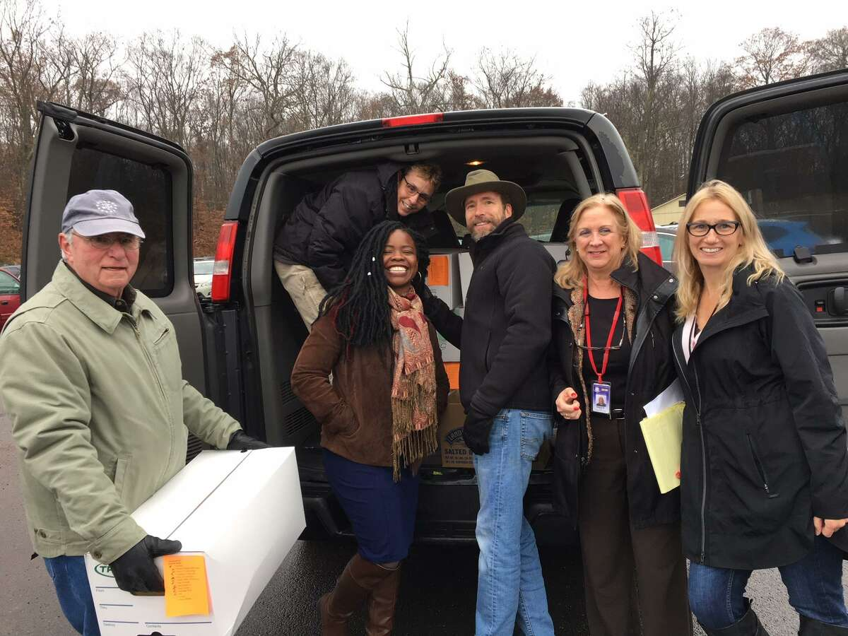 Middletown Rotarians load turkeys and Thanksgiving baskets assembled by the Middletown Community Thanksgiving Project for delivery to local families. The Rotary Club raised over $9,500 in the 2018 Liberty Bank/Rotary Club Thanksgiving Drive. From left are Chris Soulias, Cheryl Kraft, Lakisha Hyatt, Steve Lovelace, Helene Vartelas and Tracey Starbird.