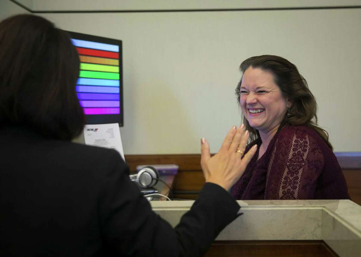 """Marie Bryant laughs with Mary Sit before the monthly Metro board meeting on November 15, 2018, in downtown Houston. Bryant provides """"closed captioning"""" for many local government meetings, plays, religious services, lecture series, etc."""
