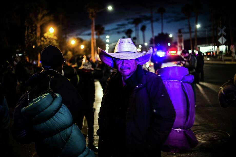 Central American migrants — mostly Hondurans — moving towards the United States in hopes of a better life, in the border city of Mexicali, Baja California state before resuming their trek to Tijuana on November 20. This does not represent the emergency that President Trump describes. Photo: PEDRO PARDO /AFP /Getty Images / AFP or licensors