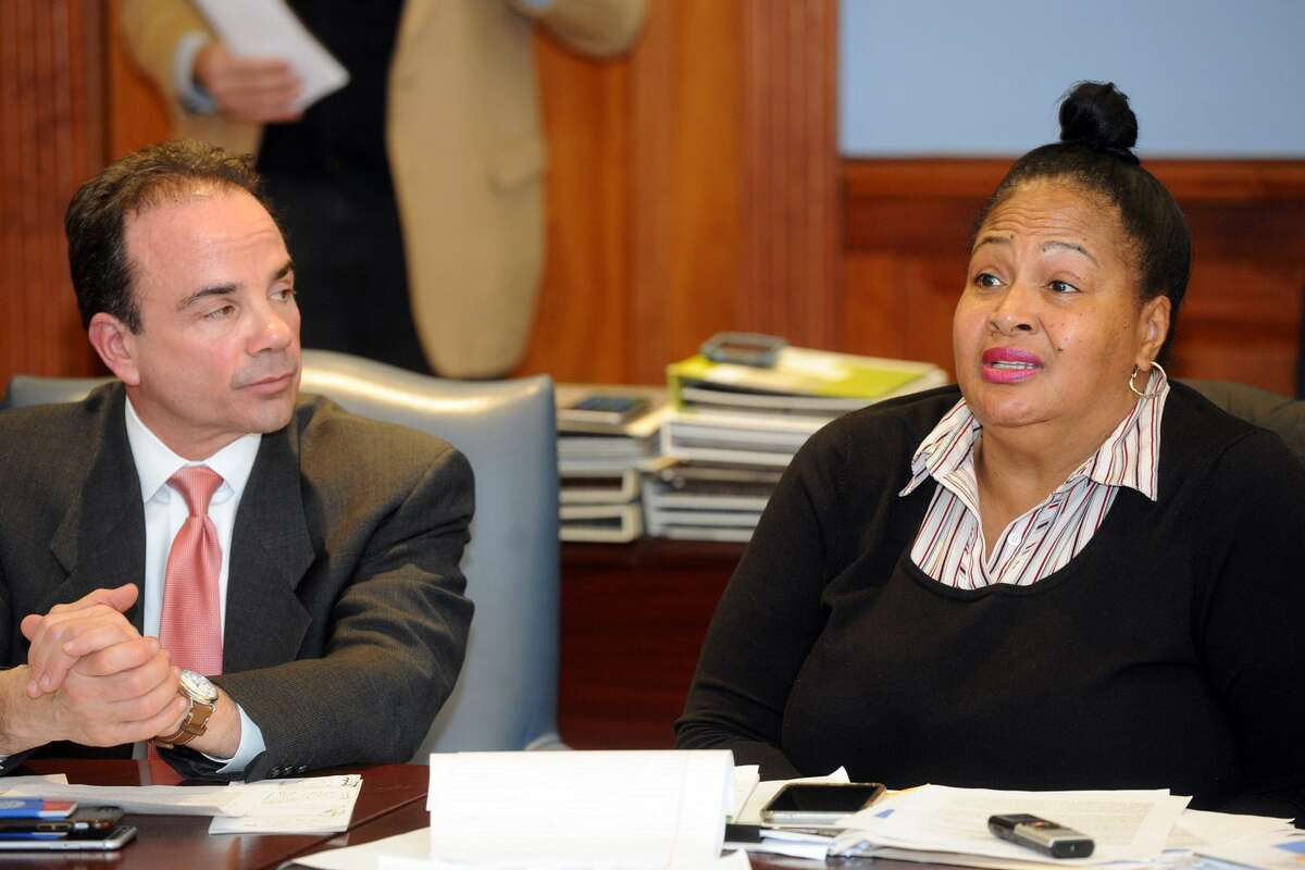 Carolyn Vermont, seen here with Mayor Joe Ganim, speaks at the monthly Communities Working for a Better and United Bridgeport meeting at the Morton Government Center in Bridgeport, Conn. Dec. 18, 2017.