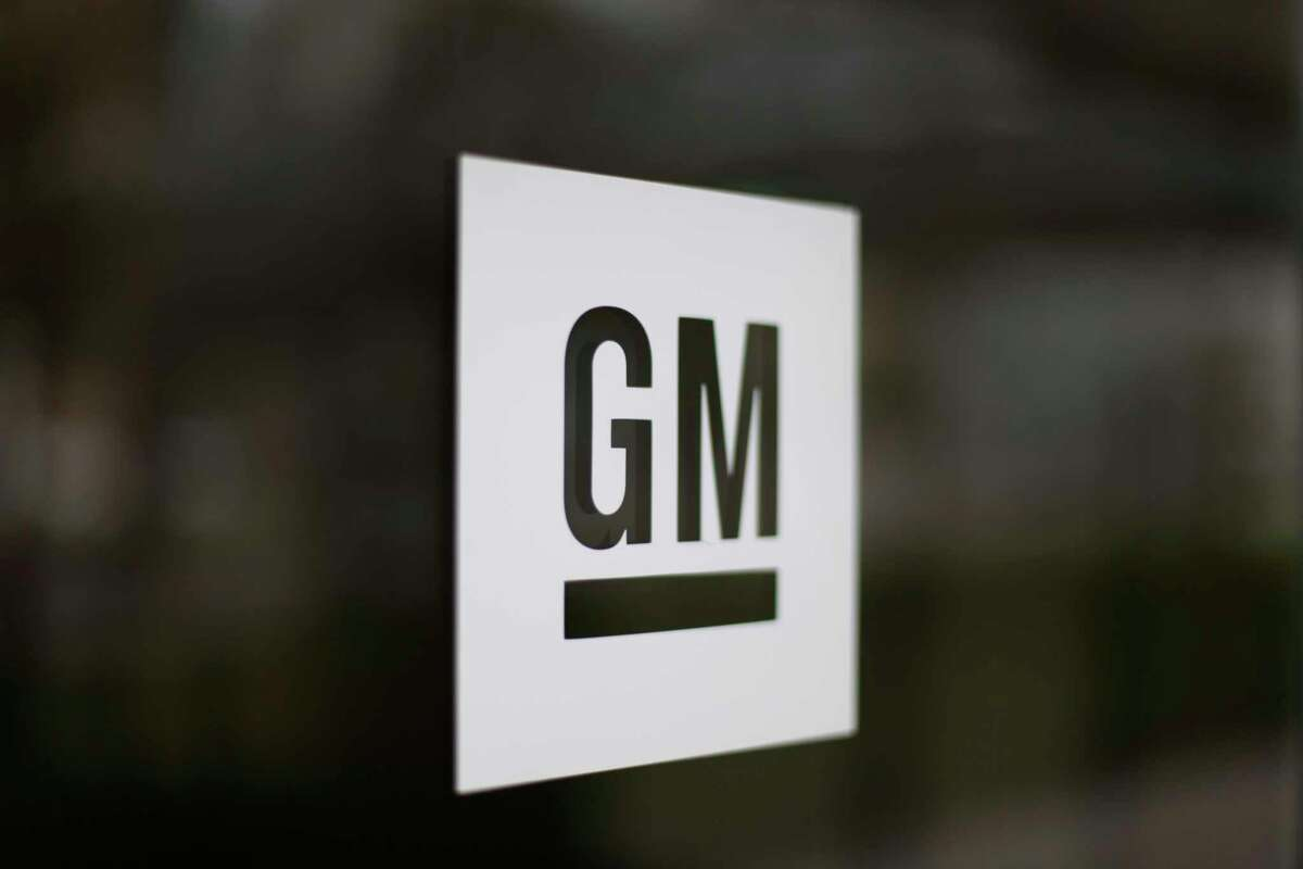 FILE - This May 16, 2014, file photo, shows the General Motors logo at the company's world headquarters in Detroit. The U.S. government is investigating more than 100 complaints of poor brake performance on 2.7 million General Motors big pickups and SUVs. The National Highway Traffic Safety Administration says a brake vacuum pump can deteriorate, causing increased braking effort and longer stopping distances. (AP Photo/Paul Sancya, File)