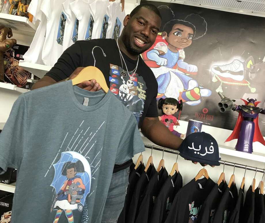 Inzzo's Shed owner Gilbert Glaster showcases several of his designs for his clothing line, Unique Knits, at his downtown store. Photo: René A. Guzman / Staff
