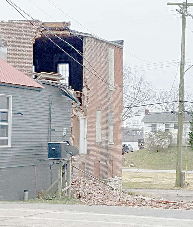 The brick wall at the back of the Bloody Bucket, 205 Main St., Grafton, began crumbling Thursday night. Bar owner Peter Allen said the destruction of the back part of the building won't have a negative impact on the front end's business. Photo: For The Telegraph