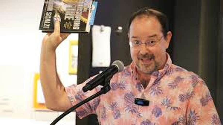 "Emily McFarlan Miller / Religion News Service Science-fiction author John Scalzi speaks about his new book, ""The Consuming Fire,"" on Oct. 22, 2018, at the American Writers Museum in Chicago."