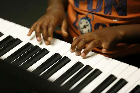 Arkadeus plays digital piano during the after-school Bridge to Arts and Music program at Third Baptist Church in San Francisco. Photo: Santiago Mejia / The Chronicle