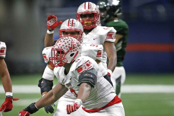Judsons Demarvin Leal celebrates after tackling Reagans Austin Miller for a loss. Judson defeated Reagan on Friday, Nov. 23, 2018, at the Alamodome.