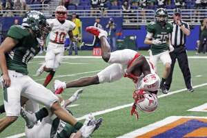 Judsons Judsons De'anthony Lewis is tripped up but scores a TD. Judson defeated Reagan on Friday, Nov. 23, 2018, at the Alamodome.