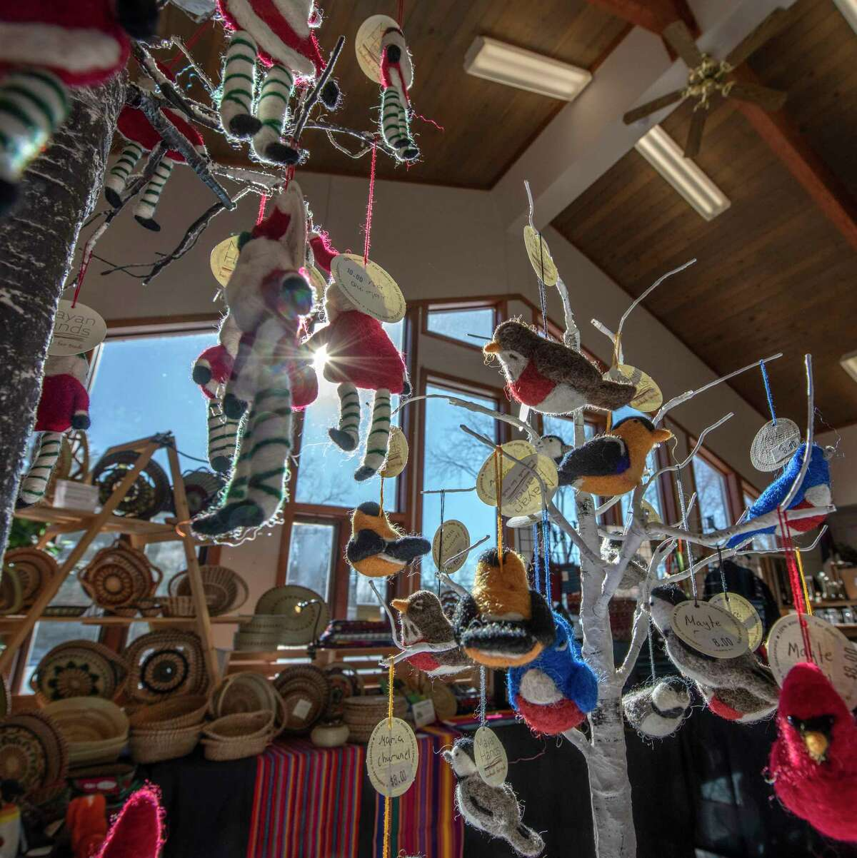 Christmas ornaments hang from a display at the Fair Trade store set up at the Delmar Presbyterian Church on Black Friday Nov. 23, 2018 in Delmar, N.Y. (Skip Dickstein/Times Union)