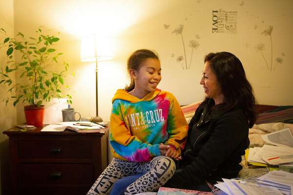 Patti Medina (right) and her daughter A.F. at Medina's home on Wednesday, Nov. 21, 2018, in Oakland, Calif.