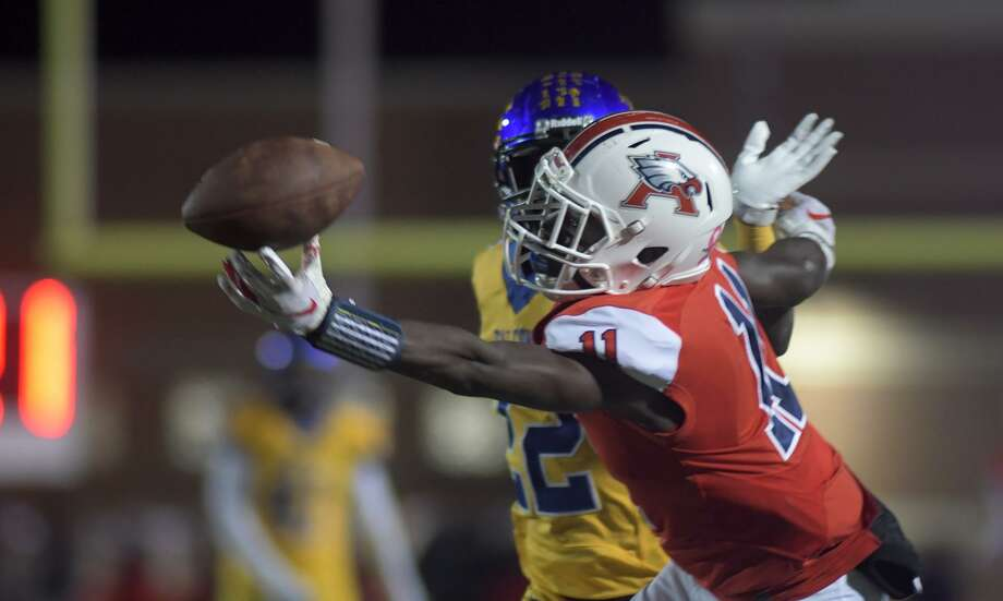 Atascocita junior wide receiver Dylan Robinson (11) balances the ball on his fingertips as he tries to finish a catch against Channelview senior defensive back Aaron Thomas in the 3rd quarter of their Class 6A Divison Region III Playoff at Turner Stadium in Humble on Nov. 16, 2018. Photo: Jerry Baker, Houston Chronicle / Contributor / Houston Chronicle