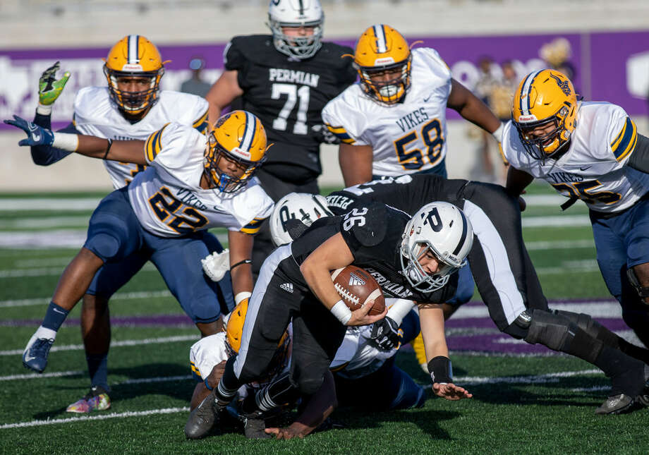 Christian Rodriguez (26) runs the ball.Permian lost to Arlington Lamar on Friday at Abilene Christian University. Photo: Jacy Lewis