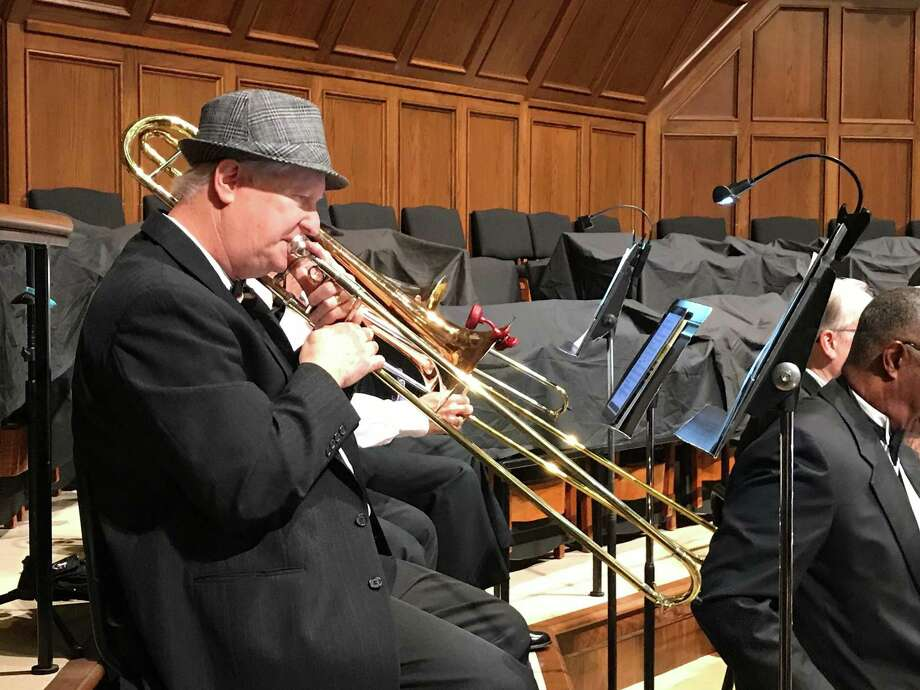 Fred Atwood plays the trombone during Energy City New Horizons Music Symphonic Band fall concert on Sunday, Nov. 18, at Memorial Drive United Methodist Church. The band has been playing for 10 years and includes musicians of varying skill levels and ages. Photo: Photo By Jack Marrion