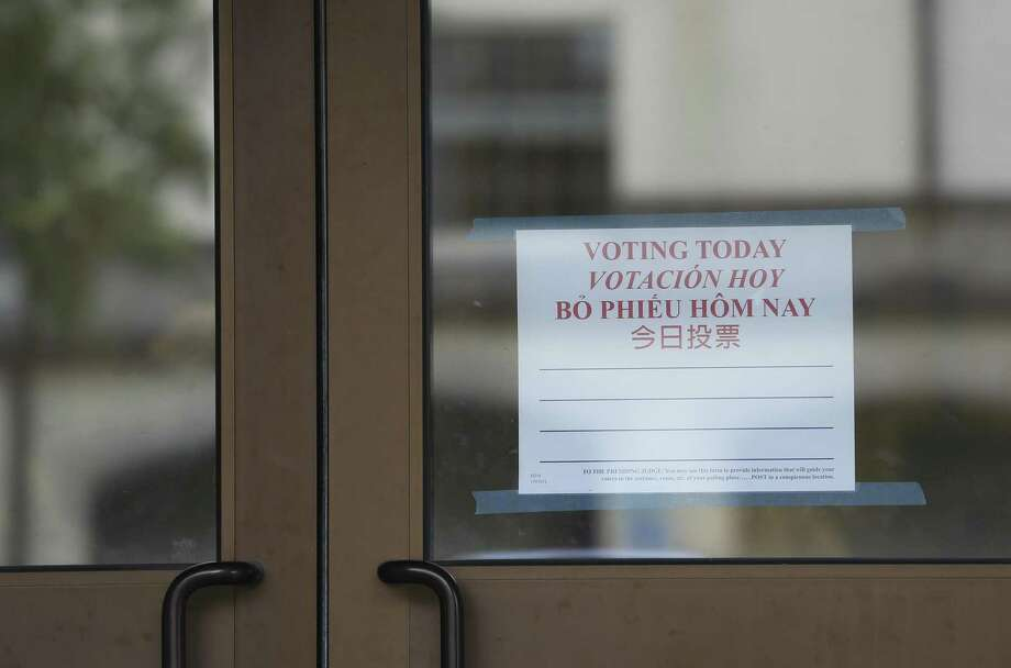 A multi-language voting sign at Precinct 15 St. Andrew's Presbyterian Church recminds voters to vote today on Election Day on Tuesday, Nov. 6, 2018, in Houston. Photo: Yi-Chin Lee, Houston Chronicle / Staff Photographer / © 2018 Houston Chronicle