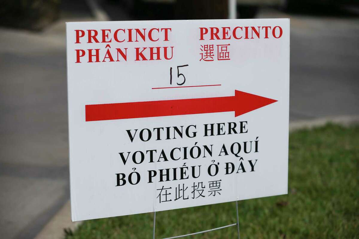 A multi-language voting sign at Precinct 15 St. Andrew's Presbyterian Church welcomes voters on Election Day on Tuesday, Nov. 6, 2018, in Houston.