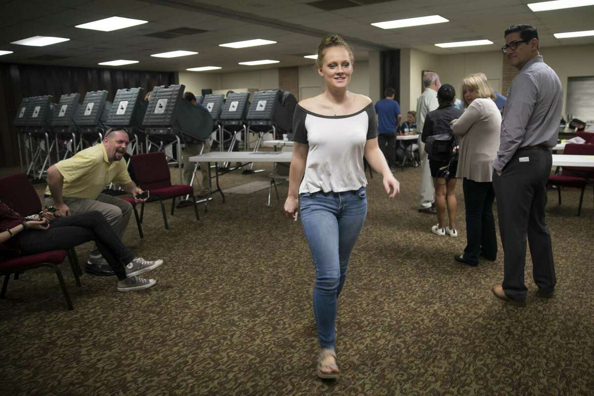 Jenna Snead, 20, walks out of the booths after voting at Willow Meadows Baptist Church on Tuesday, Nov. 6, 2018, in Houston. Snead did not receive her absentee ballot in the mail and took a last-minute bus to Houston from Kerrville, TX, where she is a junior at Shreiner University.