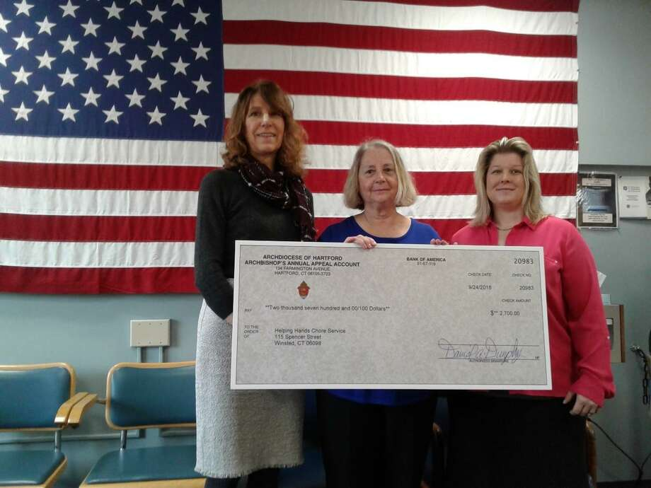 Irene Connole, Director at Helping Hands, center, and Robin Crocci & Kris Griffin, Winsted Health Center Foundation, with a donation from the Archbishop's Annual Appeal. Photo: Contributed Photo