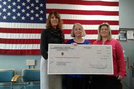 Irene Connole, Director at Helping Hands, center, and Robin Crocci & Kris Griffin, Winsted Health Center Foundation, with a donation from the Archbishop?'s Annual Appeal.