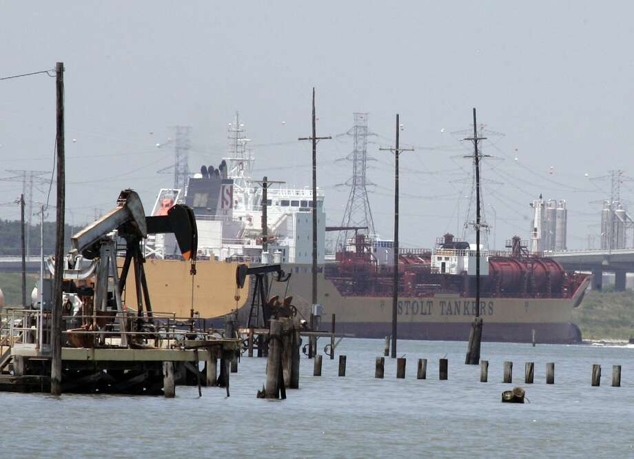 ** FILE ** In this July 14, 2008 file photo, an oil tanker makes its way up the Houston Ship channel behind working pump jacks in Baytown, Texas.  NEXT: See which countries are members of OPEC. Photo: Pat Sullivan, AP