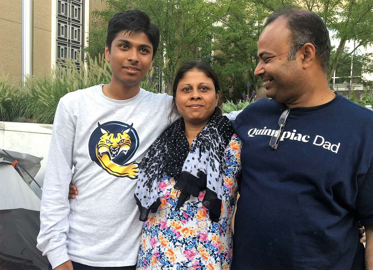 Salma Sikandar, center, with her son, Samir Mahmud, left, and husband, Anwar Mahmud, after she was granted a stay of deportation.