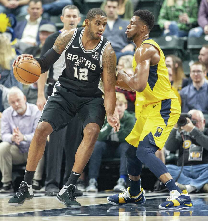 Spurs forward LaMarcus Aldridge (12) posts up Pacers forward Thaddeus Young in the Spurs' 111-100 win Friday. Photo: Doug McSchooler /Associated Press / Copyright 2018 The Associated Press. All rights reserved