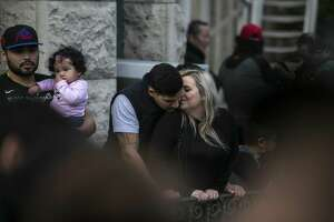 A couple shares a quiet moment while waiting for the Ford Holiday River Parade in downtown San Antonio Friday, Nov. 23, 2018.